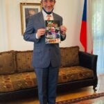 Ambassador Marek Skolil displaying Acclaim Nigeria Intn'nal Magazine at the Czech Embassy in Abuja